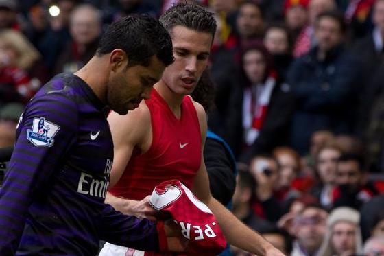 Van Persie hands Santos his Arsenal career.