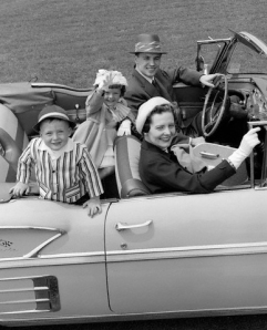 1950s Family Portrait Mother Father Son Daughter In Chevrolet Convertible Automobile